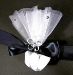 Shown here with black ribbon, glass flower and stick on diamonds